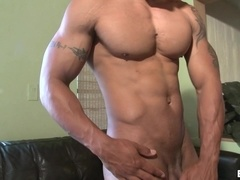 Muscular black stud Robert Axel jerks his hard dick in the living room