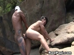 Horny Latino gay gets his butt banged by black dude outdoors