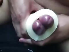 Buddies using a cock sleeve together with nice cumshots