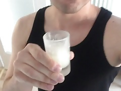 Drinking a cup of cum