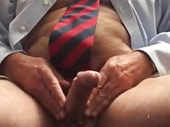 Suit man is wanking his cock!