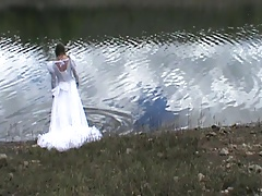 big wedding gown in a lake