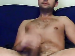 Hot guy wanking on couch