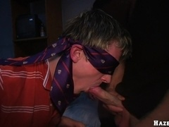 Blindfolded fair-haired gay gives a blowjob to a stranger