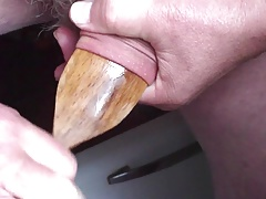 Large wooden spoon stretches foreskin !