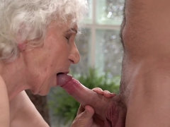 Young buck has a long piece of the shaft for dirty old grandmother