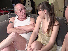 grandpa watches granddaughter romping