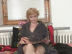 Slender blonde old lady spreads legs for two guys