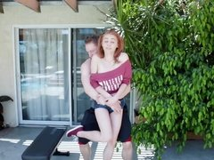 Redhead Kandi Quinn helps her neighbor with his cardio