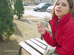 adorable Russian dark-haired smoking butt-plug cigarette during interview