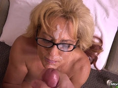 Busty mature wanks big cock and takes massive facial all over her face