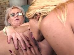 Nerdy granny and sweet blonde have awesome lesbian sex on sofa