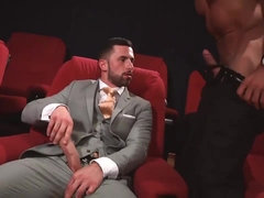 Two handsome gays fuck in the cinema