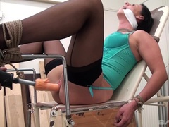 Terra Sweet gets a dildo on a fucking machine as she is bound to a chair