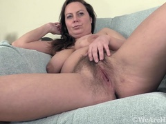 Alexis May strips naked on her blue chair