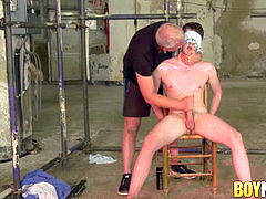 bound and blindfolded slave deepthroated by mature tormentor Sebastian