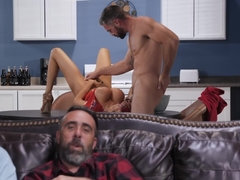 Busty housewife cheats on her husband while he is watching a big game