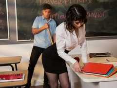 Slutty teacher Audrey Noir passionately sucks and fucks in the classroom
