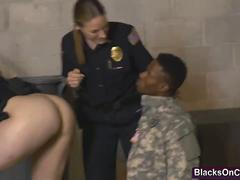 A handsome fake black soldier must satisfy lusty female cops if wants to avoid jail