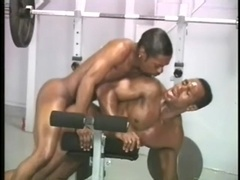 Two ebony queers enjoy some ardent banging in a gym