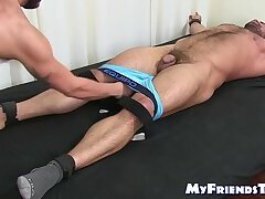Bound muscular hairy hunk endures tickling torment from dom