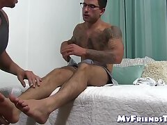Tattooed amateur jacks off while his buddy fucks his feet