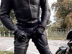 blows on balls and cock in full leather suit