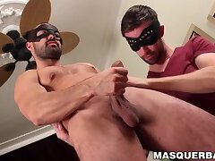 Masked stud allows his lover to help him cum with a blowjob