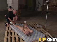 Submissive twinks have their cocks stroked by their master