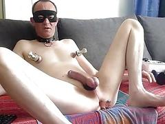 Toying with his tits and prick