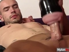 Kinky queer wearing pantyhose masturbates his dick with a fleshlight