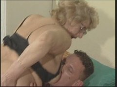 A blonde gran with glasses rides her hot immature boy