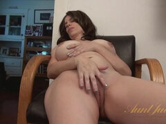 Kelly Capone masturbates with her fingers and feet.