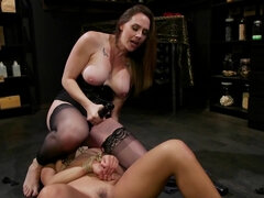 MILF in stockings uses tied up girl to receive sexual pleasure