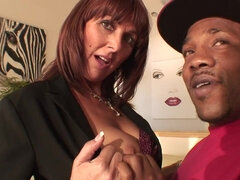 Busty MILF's cunt gets stretched by huge black dick
