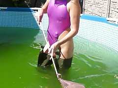 In Waders and shiny sexy swimsuit