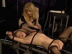 Stockinged blondie getting drilled by a big fucking machine