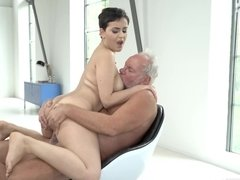 Short-haired cutie nicely jumps on cock of skillful old guy