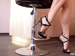 ambling on high stilettos showcasing legs and feet