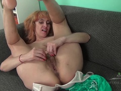 Karolina strips and masturbates