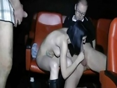 couple & a voyuer in a cinema