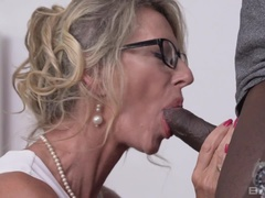 Marina Beaulieu takes a big black cock down to the balls then swallows