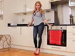 Busty blonde fingers herself in the kitchen