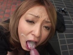 Japanese darling is down on her knees with a cock in her mouth