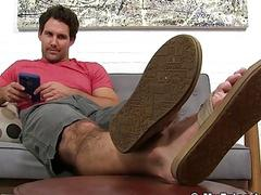 Devious dude with hairy feet wiggles his toes