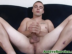 Solo marine tugging his fat cock in closeup