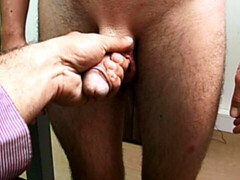 Submissive guy pleasuring a hard uncut cock in a casting vid