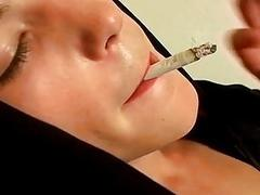Twink performs a striptease while smoking and jerks off solo
