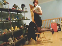 Crossdressing stripping out of secretary outfit