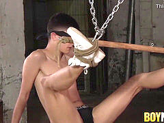 Sebastian Kane tortures draping twink Axel Rubberax with wax